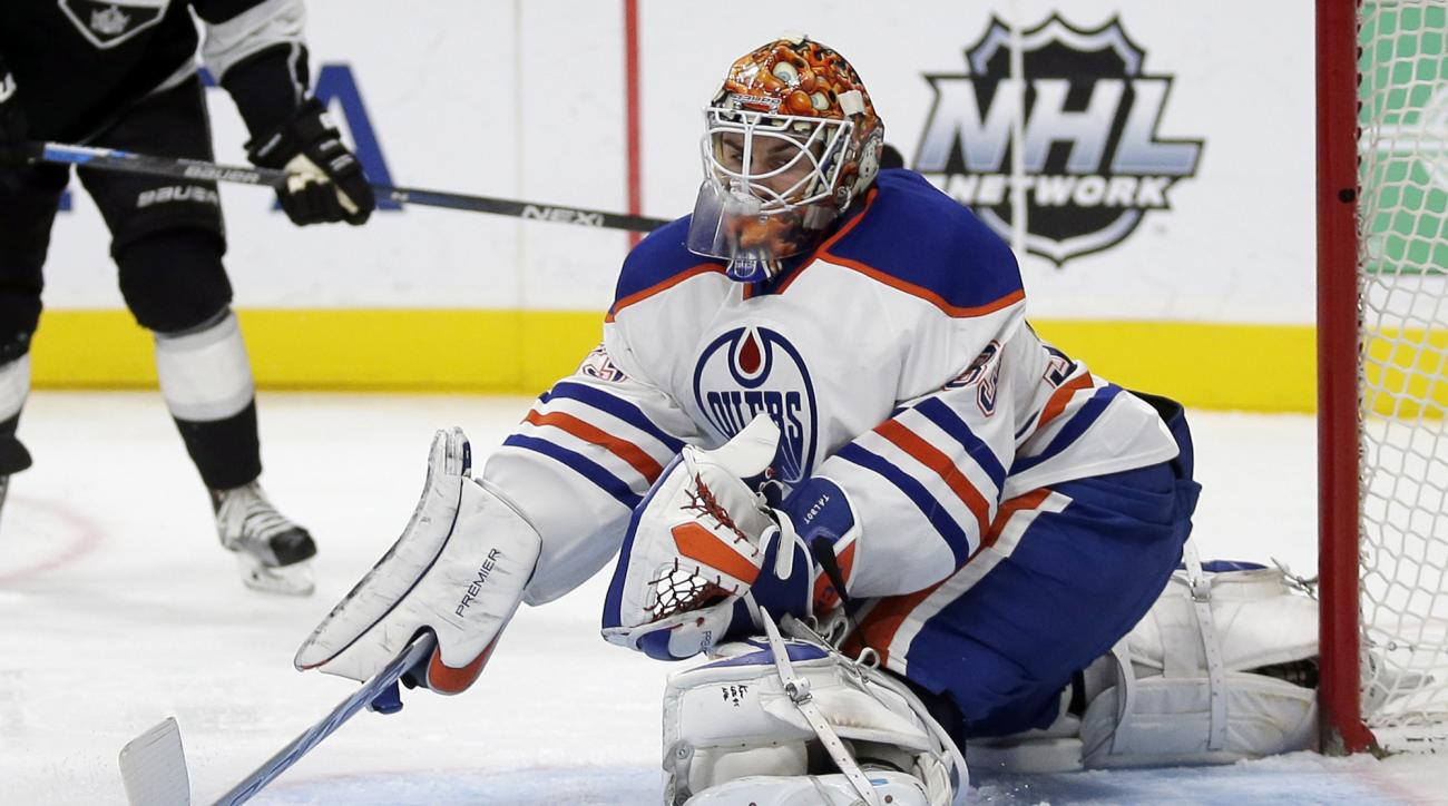 Edmonton Oilers goalie Cam Talbot blocks a shot against the Los Angeles Kings during the second period of an NHL hockey game in Los Angeles, Saturday, Nov. 14, 2015. (AP Photo/Chris Carlson)