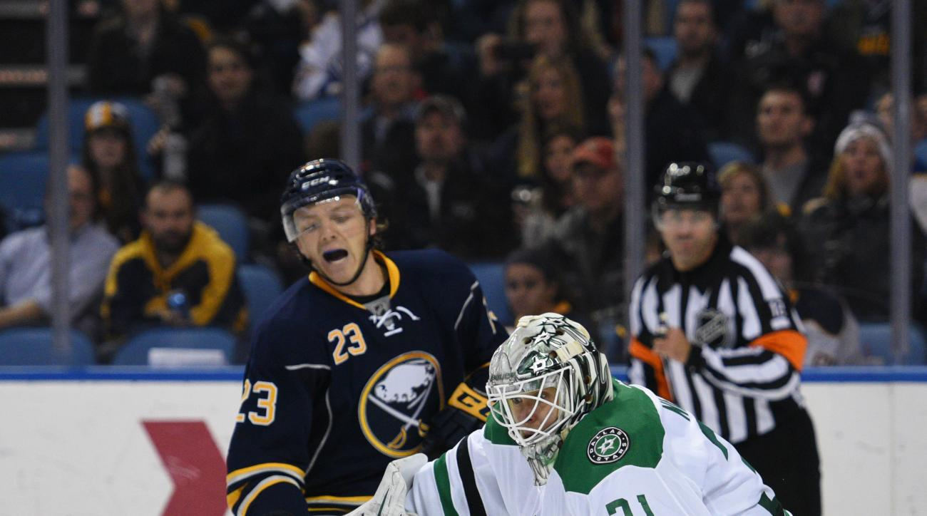 Buffalo Sabres center Sam Reinhart (23) reacts as Dallas Stars goaltender Antti Niemi (31), of Finland, makes a save during the first period of an NHL hockey game, Tuesday Nov. 17, 2015 in Buffalo, N.Y. (AP Photo/Gary Wiepert)