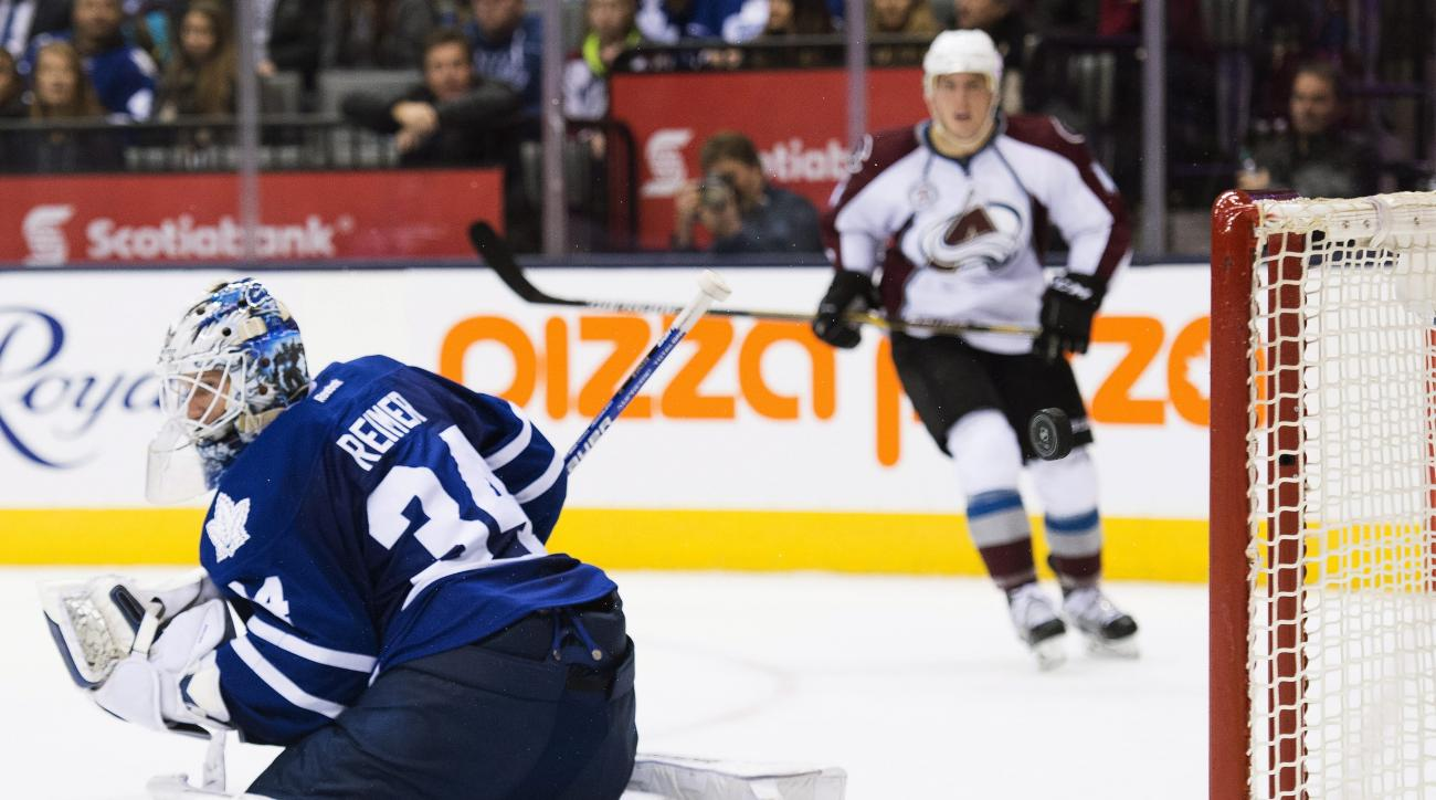 Toronto Maple Leafs goalie James Reimer (34) gets some help as the puck hits the goal post while playing against the Colorado Avalanche during the third period of an NHL hockey game in Toronto on Tuesday, Nov. 17, 2015. (Nathan Denette/The Canadian Press