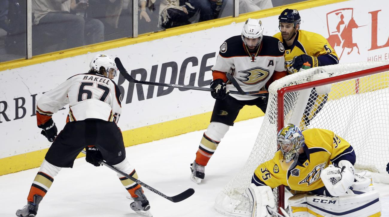 Nashville Predators goalie Pekka Rinne (35), of Finland, blocks a shot by Anaheim Ducks center Rickard Rakell (67), of Sweden, in the third period of an NHL hockey game Tuesday, Nov. 17, 2015, in Nashville, Tenn. The Predators won 3-2. (AP Photo/Mark Hump