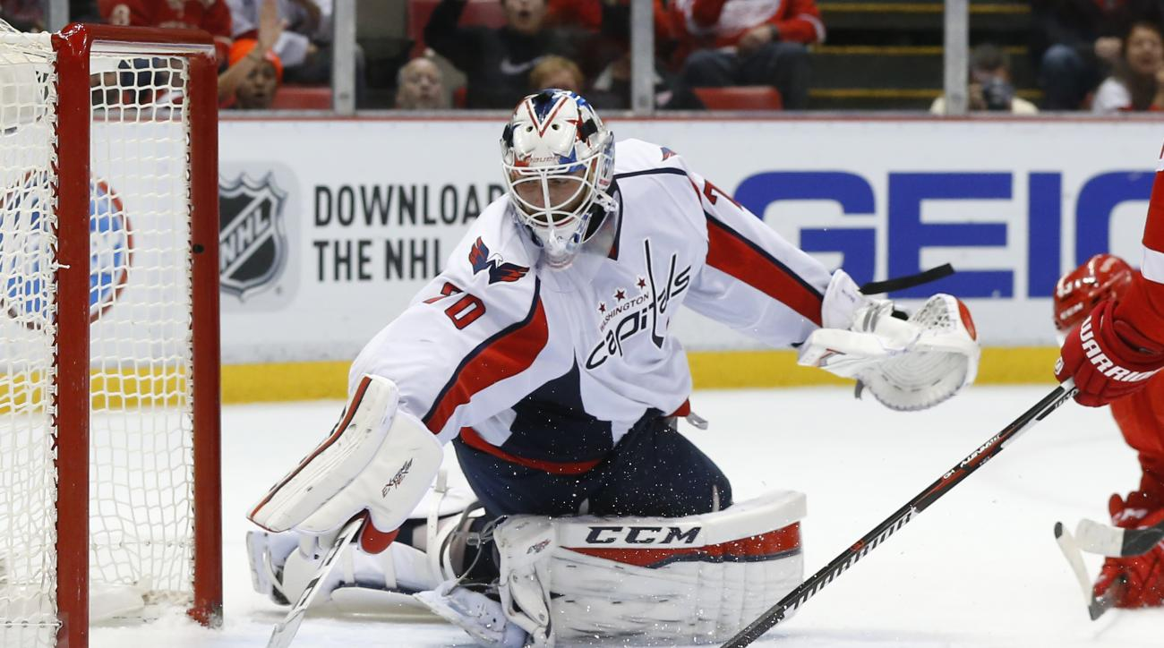Washington Capitals goalie Braden Holtby (70) stops a Detroit Red Wings shot in the second period of an NHL hockey game, Wednesday, Nov. 18, 2015 in Detroit. (AP Photo/Paul Sancya)