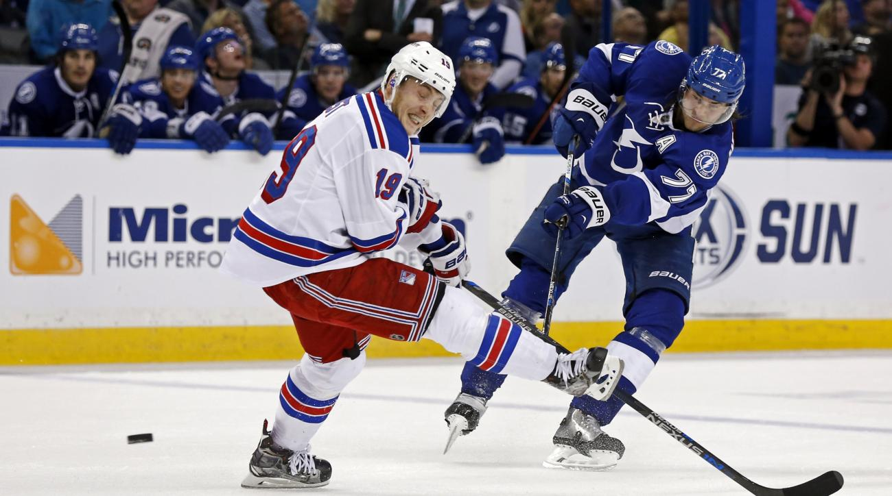 Tampa Bay Lightning's Victor Hedman, of Sweden, shoots past New York Rangers' Jesper Fast, of Sweden, during the second period of an NHL hockey game Thursday, Nov. 19, 2015, in Tampa, Fla. (AP Photo/Mike Carlson)