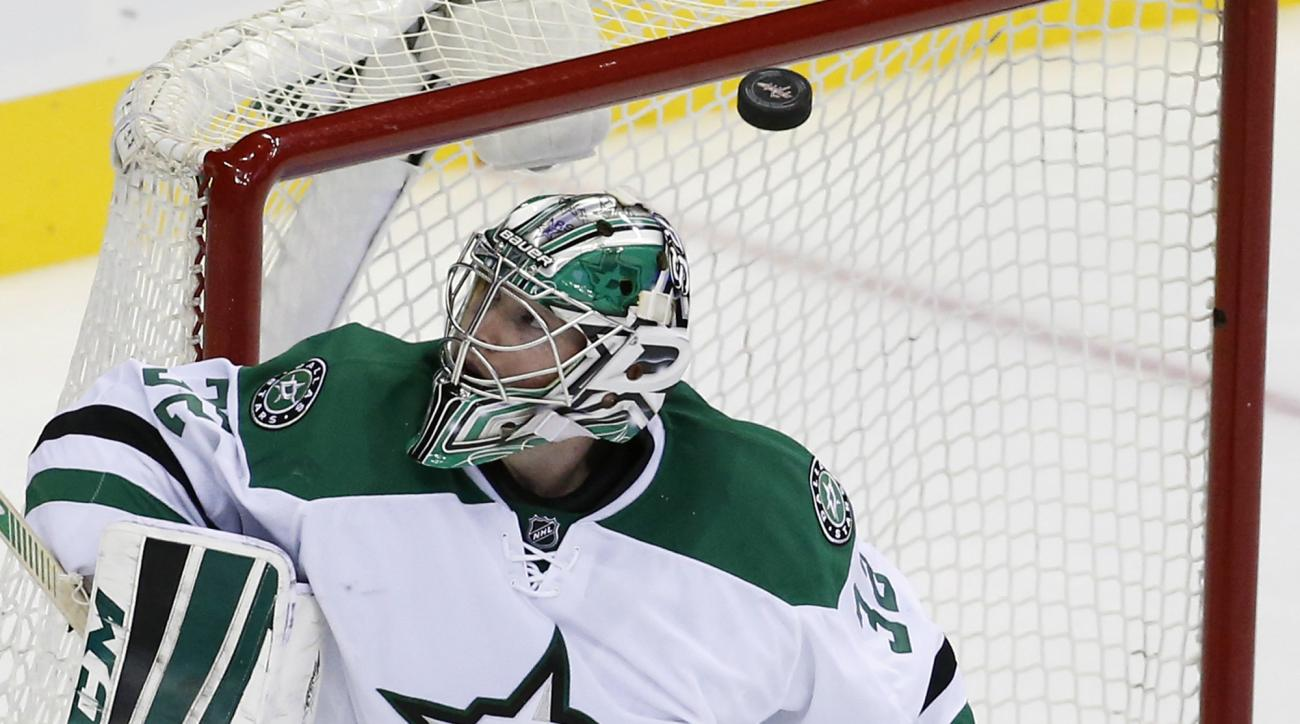 Dallas Stars goalie Kari Lehtonen, from Finland, watches as the puck bounces off the pipe during the third period of an NHL hockey game against the Washington Capitals, Thursday, Nov. 19, 2015, in Washington. The Stars won 3-2. (AP Photo/Alex Brandon)