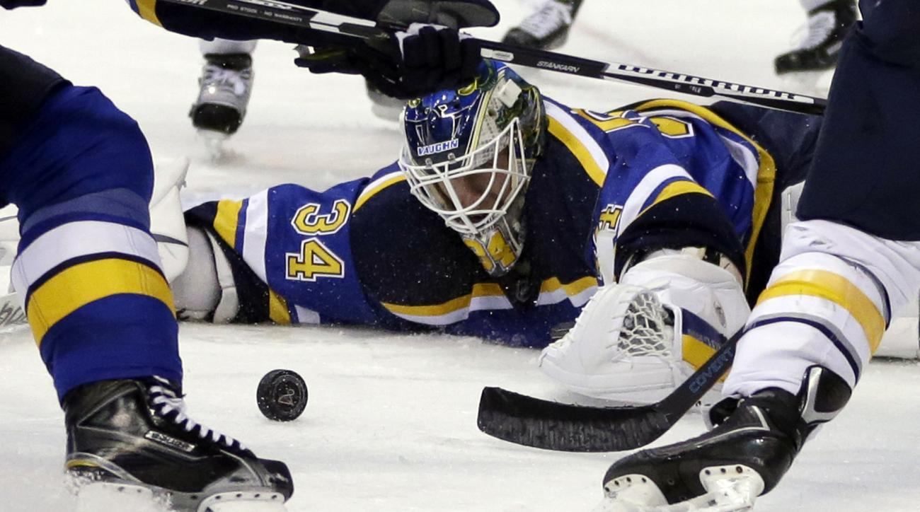 St. Louis Blues goalie Jake Allen keeps his eye on a loose puck during the third period of an NHL hockey game against the Buffalo Sabres Thursday, Nov. 19, 2015, in St. Louis. The Blues won 3-2 in a shootout. (AP Photo/Jeff Roberson)