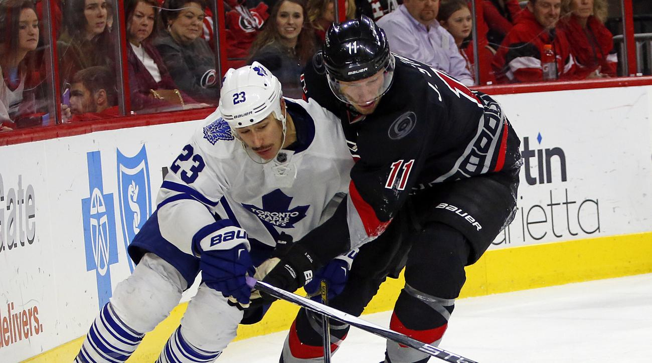 Carolina Hurricanes' Jordan Staal (11) battles with Toronto Maple Leafs' Shawn Matthias (23) during the second period of an NHL hockey game, Friday, Nov. 20, 2015, in Raleigh, N.C. (AP Photo/Karl B DeBlaker)