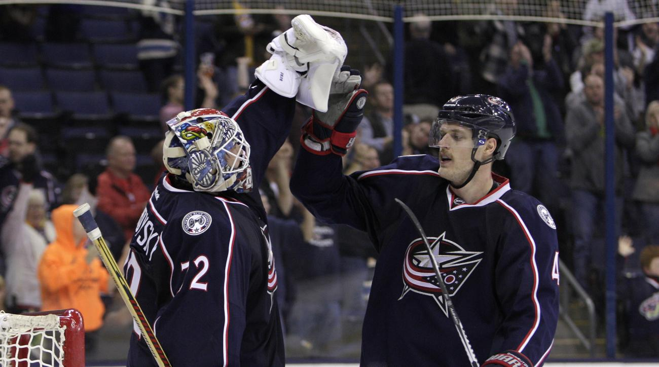Columbus Blue Jackets' Kevin Connauton, right, congratulates Sergei Bobrovsky, of Russia, after their win over the Nashville Predators during the third period of an NHL hockey game Friday, Nov. 20, 2015, in Columbus, Ohio. The Blue Jackets beat the Predat