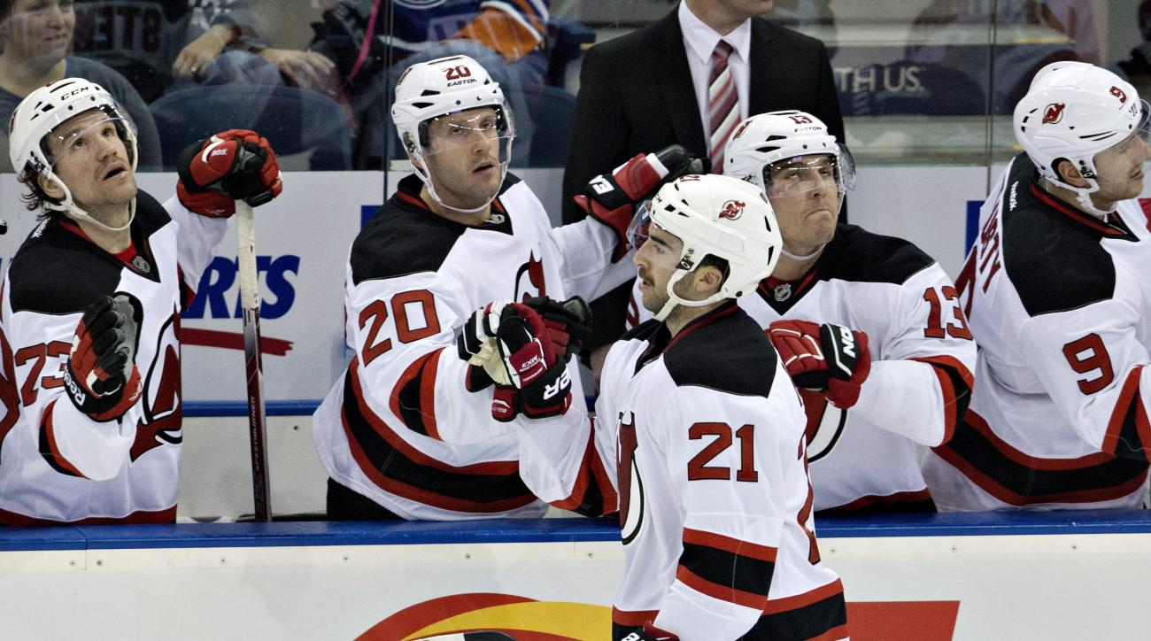 New Jersey Devils' Kyle Palmieri (21) celebrates a goal with his teammates against the Edmonton Oilers during second period NHL action in Edmonton, Alberta Friday, Nov. 20, 2015. (Jason Franson/The Canadian Press via AP)