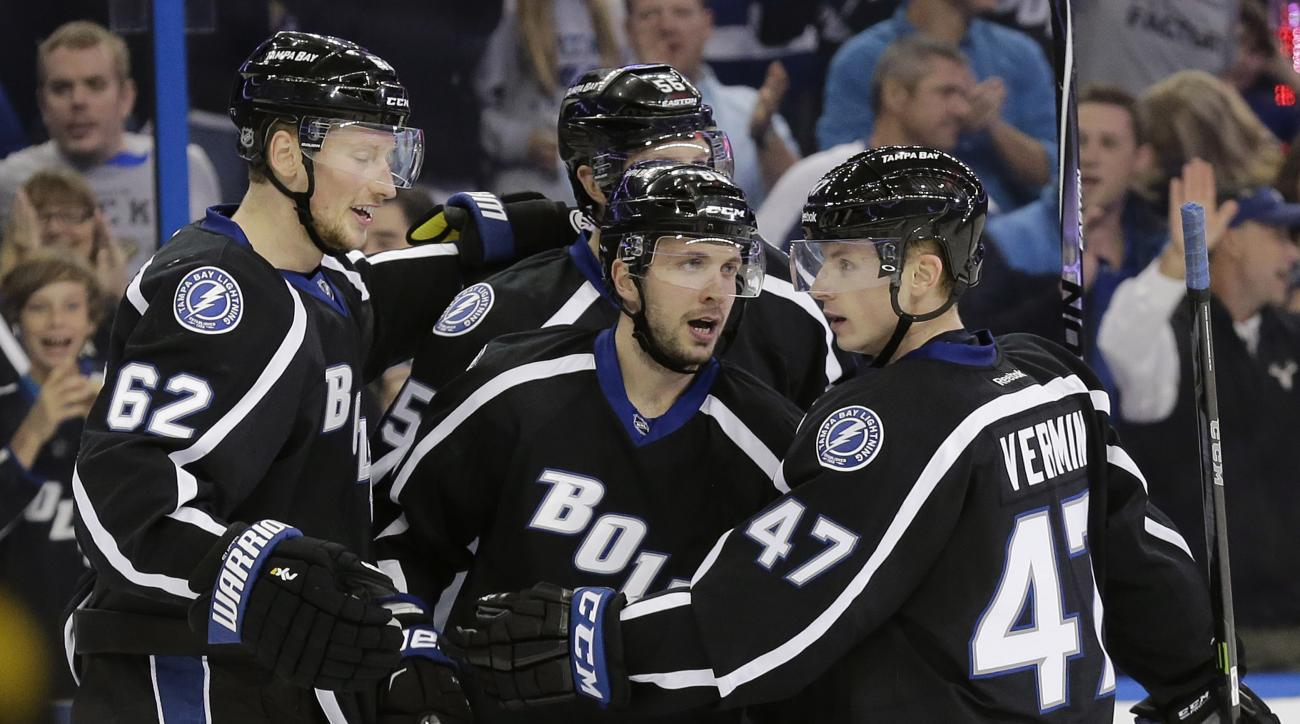 Tampa Bay Lightning right wing Nikita Kucherov, center, of Russia, celebrates his goal Anaheim Ducks with teammates Andrej Sustr, left, of the Czech Republic, and Joel Vermin, right, during the second period of an NHL hockey game Saturday, Nov. 21, 2015,