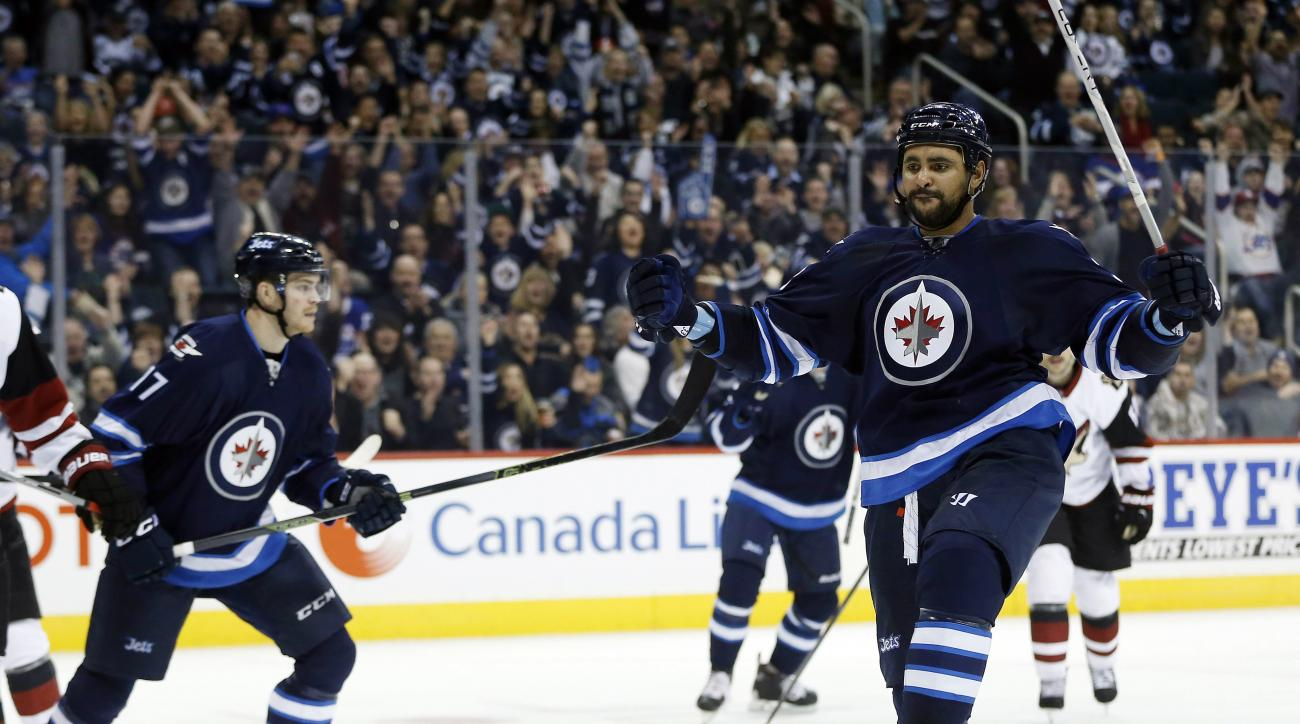 Winnipeg Jets' Dustin Byfuglien (33) celebrates his goal against the Arizona Coyotes during the second period of an NHL hockey game, in Winnipeg, Manitoba on Saturday, Nov. 21, 2015. (John Woods/The Canadian Press via AP) MANDATORY CREDIT