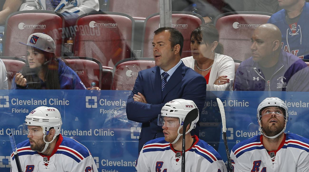 New York Rangers Head coach Alain Vigneault looks on during the overtime period of an NHL hockey game against the Florida Panthers, Saturday, Nov. 21, 2015, in Sunrise, Fla. The Rangers defeated the Panthers 5-4 in overtime. (AP Photo/Joel Auerbach)