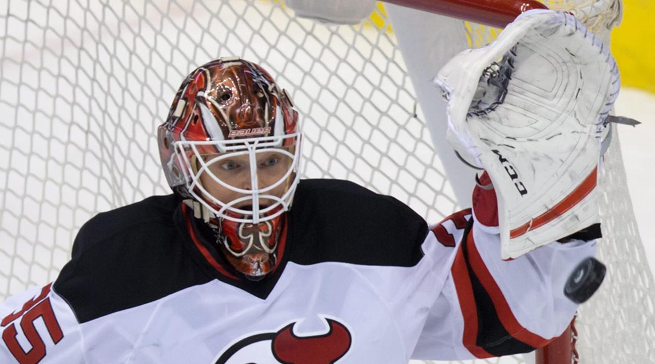 New Jersey Devils' goalie Cory Schneider makes a glove save against the Vancouver Canucks during the second period of an NHL hockey game in Vancouver, British Columbia, on Sunday, Nov 22, 2015. (Darryl Dyck/The Canadian Press via AP)