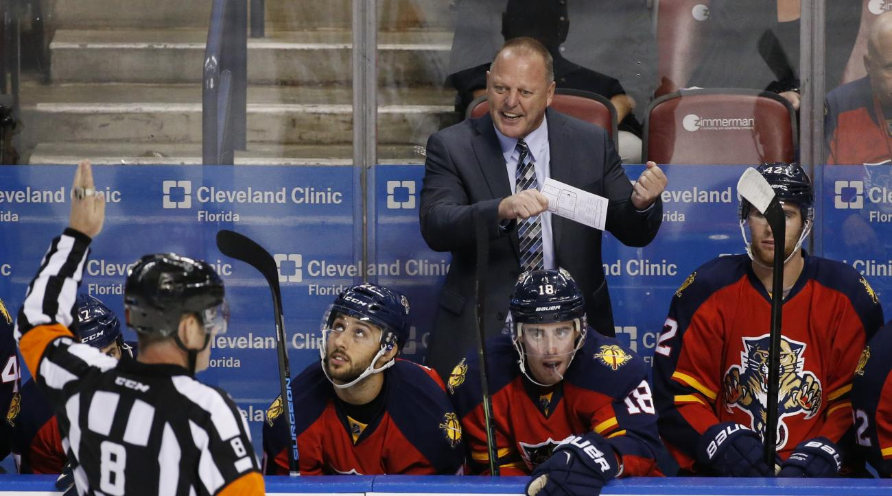Florida Panthers head coach Gerard Gallant, center rear, argues a call with referee Dave Jackson (8) during the second period of an NHL hockey game against the Los Angeles Kings, Monday, Nov. 23, 2015 in Sunrise, Fla. The Kings defeated the Panthers 3-1.