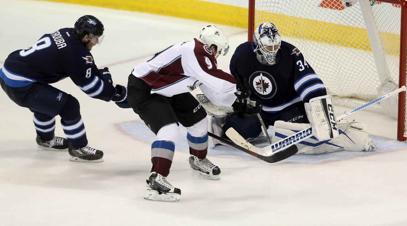 Winnipeg Jets' Jacob Trouba (8) is unable to stop Colorado Avalanche's Matt Duchene (9) as he scores on goaltender Michael Hutchinson (34) during the third period of an NHL hockey game in Winnipeg, Manitoba, Monday, Nov. 23, 2015. (Trevor Hagan/The Canadi