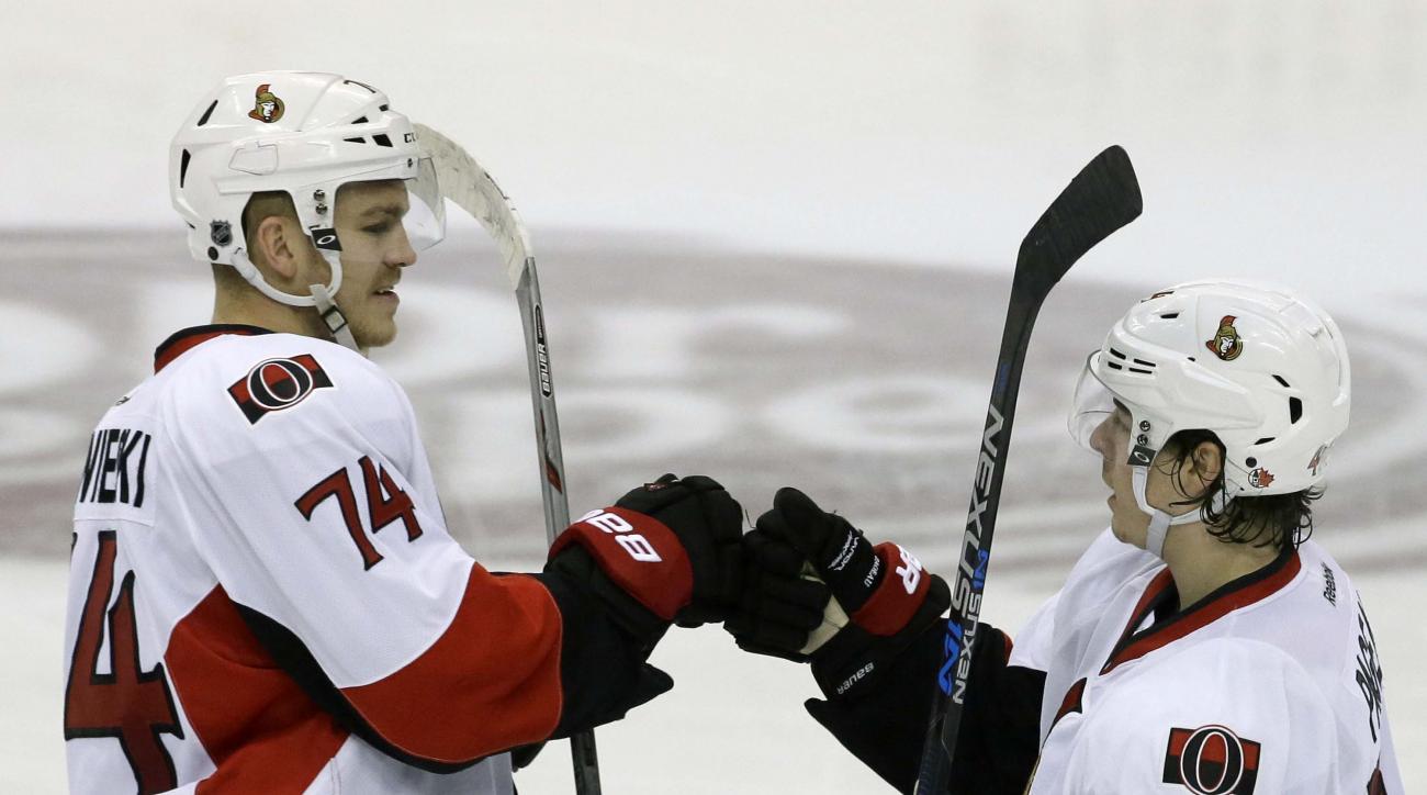 Ottawa Senators center Jean-Gabriel Pageau (44) celebrates his goal with teammate Mark Borowiecki (74) during the third period of an NHL hockey game against the Dallas Stars Tuesday, Nov. 24, 2015, in Dallas. The Senators won 7-4. (AP Photo/LM Otero)