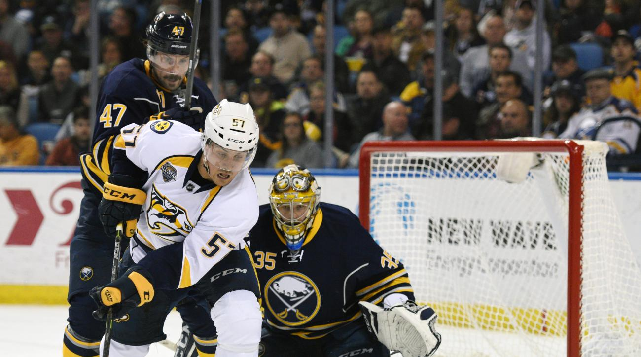 Buffalo Sabres defenseman Zach Bogosian (47) and goaltender Linus Ullmark (35) defend as Nashville Predators right winger Gabriel Bourque (57) battles for the puck during the second period of an NHL hockey game, Wednesday Nov. 25, 2015 in Buffalo, N.Y. (A