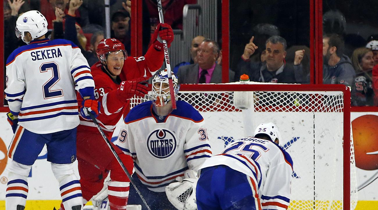Carolina Hurricanes' Jeff Skinner (53) celebrates his goal after battling Edmonton Oilers' Andrej Sekera (2), Darnell Nurse (25) and goalie Anders Nilsson (39) during the second period of an NHL hockey game, Wednesday, Nov. 25, 2015, in Raleigh, N.C. The