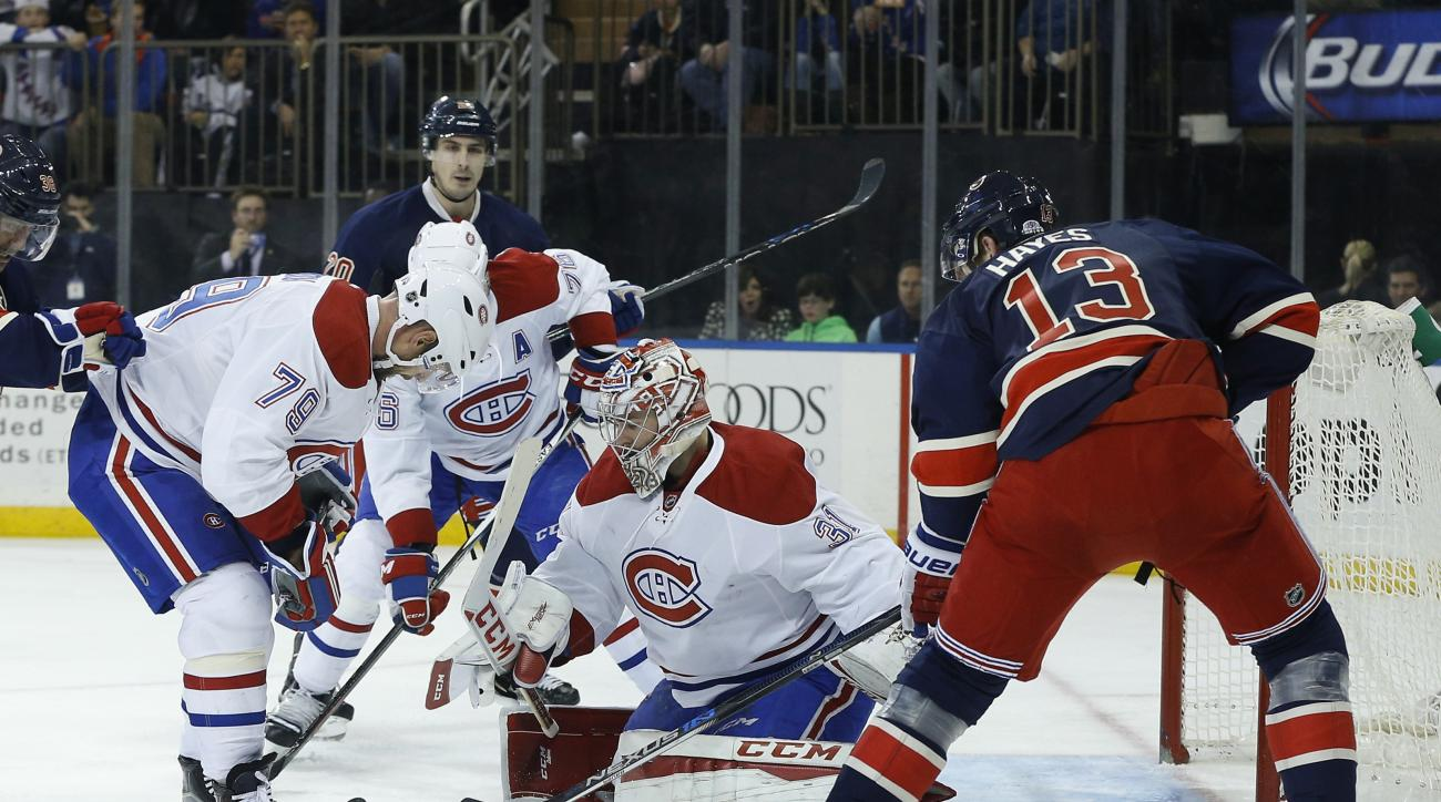 Montreal Canadiens goalie Carey Price (31) blocks a shot by New York Rangers right wing Kevin Hayes (13) as Canadiens defenseman Andrei Markov (79) looks for a rebound during the second period of an NHL hockey game, Wednesday, Nov. 25, 2015, in New York.