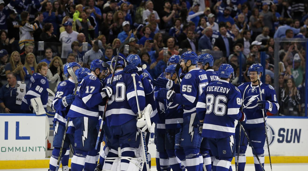Members of the Tampa Bay Lightning celebrate their win over the Los Angeles Kings after an NHL hockey game Wednesday, Nov. 25, 2015, in Tampa, Fla. The Lightning won 2-1.  (AP Photo/Mike Carlson)