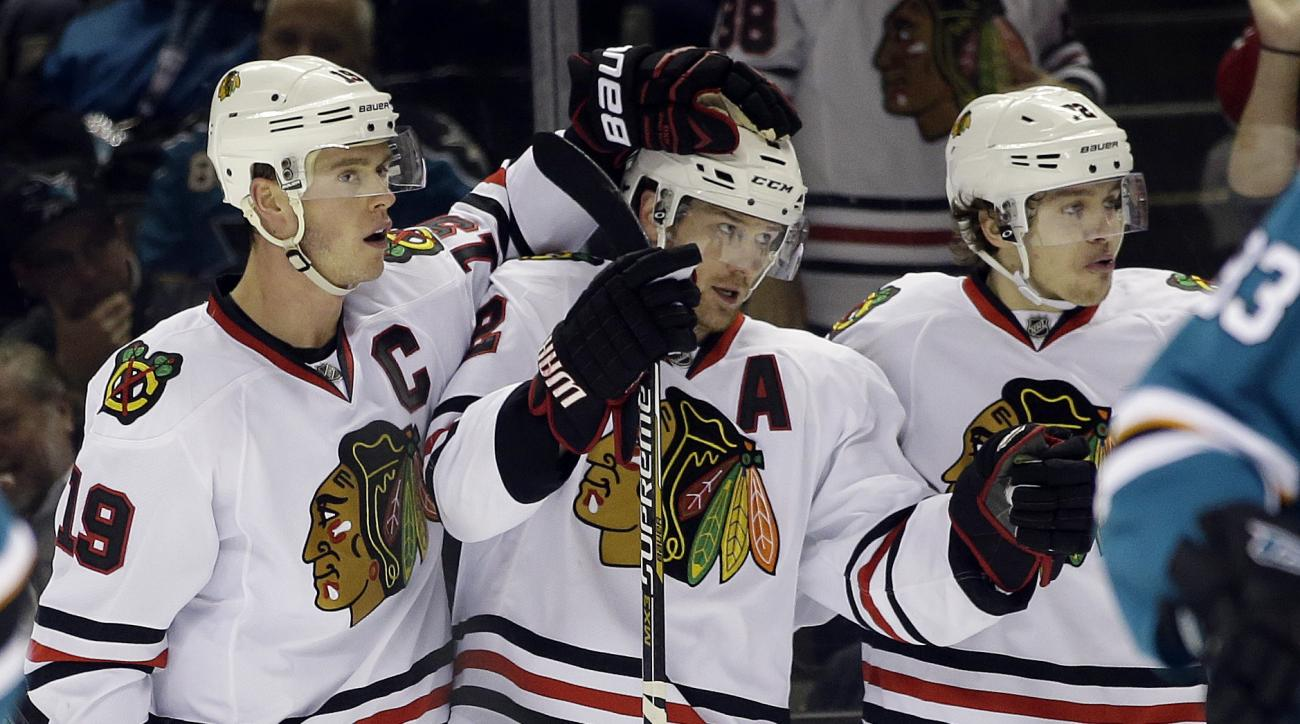 Chicago Blackhawks' Duncan Keith (2) celebrates his goal with teammates Jonathan Toews (19) and Artemi Panarin (72) during the second period of an NHL hockey game Wednesday, Nov. 25, 2015, in San Jose, Calif. (AP Photo/Marcio Jose Sanchez)