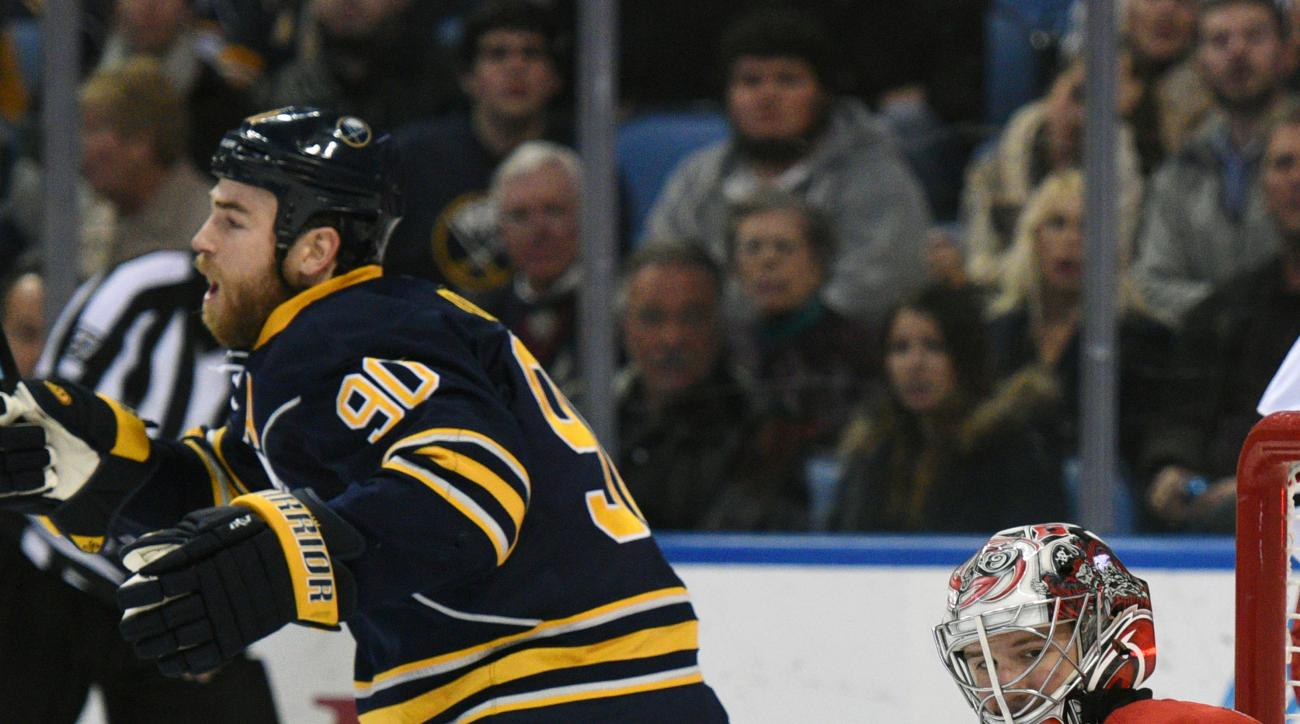 Buffalo Sabres center Ryan O'Reilly (90) celebrates a goal by Josh Georges as Carolina Hurricanes goaltender Cam Ward (30) reacts during the first period of an NHL hockey game, Friday Nov. 27, 2015 in Buffalo, N.Y. (AP Photo/Gary Wiepert)