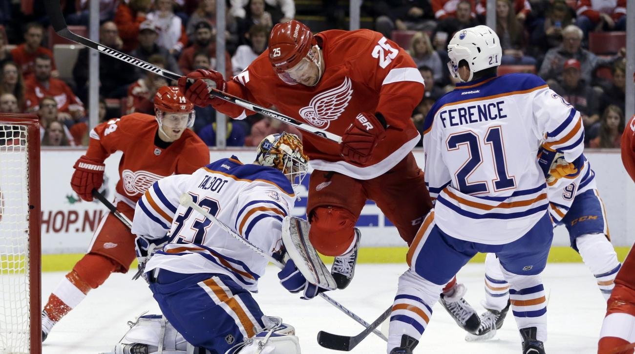 Detroit Red Wings defenseman Mike Green (25) screens Edmonton Oilers goalie Cam Talbot (33) before Detroit Red Wings center Gustav Nyquist (14) of Sweden scores on a during the second period of an NHL hockey game, Friday, Nov. 27, 2015, in Detroit. (AP Ph