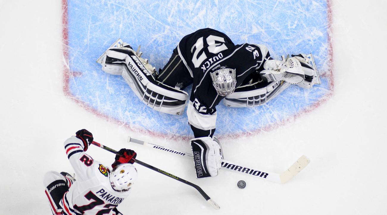 Los Angeles Kings goalie Jonathan Quick, top, stops a shot by Chicago Blackhawks left wing Artemi Panarin, of Russia, during the second half of an NHL hockey game, Saturday, Nov. 28, 2015, in Los Angeles. (AP Photo/Mark J. Terrill)