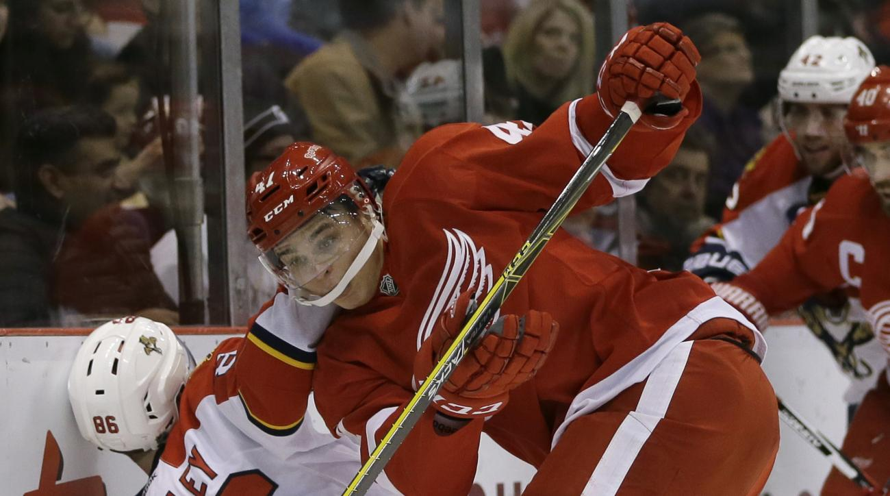 Detroit Red Wings defenseman Alexei Marchenko (47) of Russia checks Florida Panthers center Connor Brickley (86) during the first period of an NHL hockey game, Sunday, Nov. 29, 2015, in Detroit. (AP Photo/Carlos Osorio)