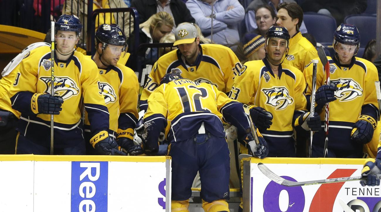 Nashville Predators forward Mike Fisher (12) leaves the ice after being injured in the second period of an NHL hockey game against the Arizona Coyotes, Tuesday, Dec. 1, 2015, in Nashville, Tenn. (AP Photo/Mark Humphrey)