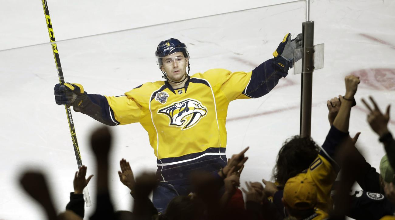 Nashville Predators center Filip Forsberg, of Sweden, celebrates after scoring a goal against the Arizona Coyotes in the third period of an NHL hockey game, Tuesday, Dec. 1, 2015, in Nashville, Tenn. (AP Photo/Mark Humphrey)