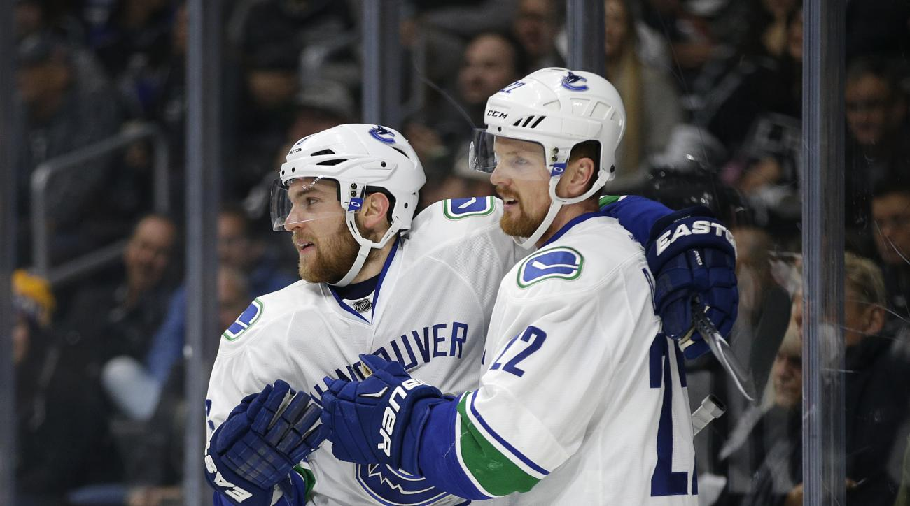Vancouver Canucks' Daniel Sedin, right, of Sweden, celebrates his goal with teammate Yannick Weber, of Switzerland, during the first period of an NHL hockey game against the Los Angeles Kings, Tuesday, Dec. 1, 2015, in Los Angeles. (AP Photo/Jae C. Hong)