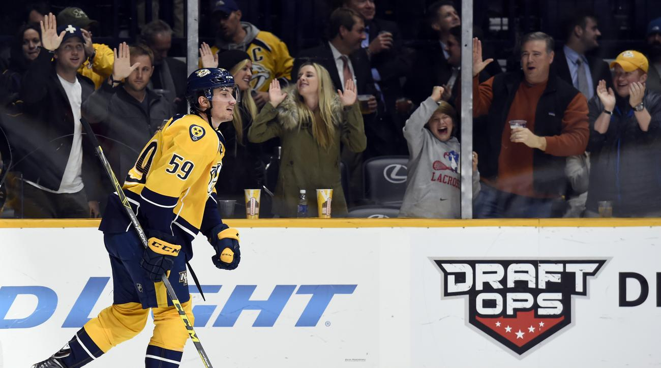 Nashville Predators defenseman Roman Josi (59), of Switzerland, skates to the bench after scoring a goal in second period of an NHL hockey game against the Florida Panthers, Thursday, Dec. 3, 2015, in Nashville, Tenn.  (AP Photo/Mark Zaleski)