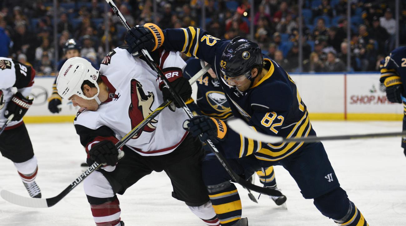 Arizona Coyotes right winger Steve Downie, left, competes for the puck with Buffalo Sabres left winger Marcus Foligno (82) during the second period of an NHL hockey game Friday Dec. 4, 2015 in Buffalo, N.Y. (AP Photo/Gary Wiepert)