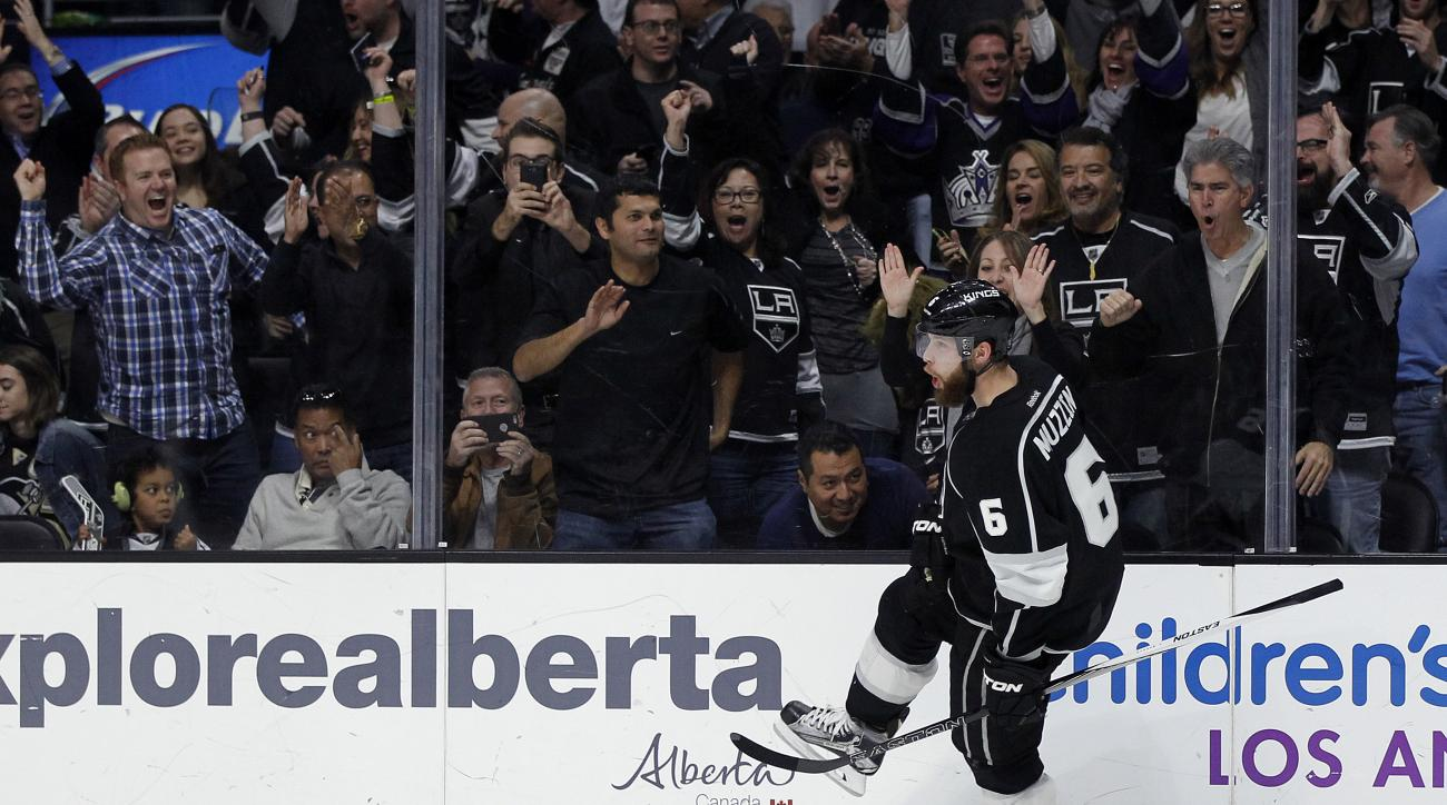 Los Angeles Kings defenseman Jake Muzzin (6) reacts after scoring against the Pittsburgh Penguins during the second period of an NHL hockey game in Los Angeles, Saturday, Dec. 5, 2015. (AP Photo/Alex Gallardo)