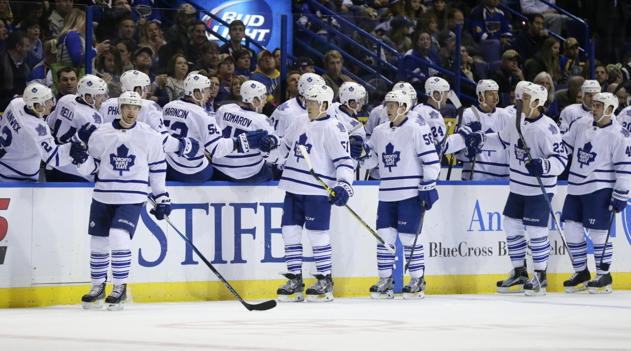 Toronto Maple Leafs' Roman Polak (46), far right, celebrates with teammates after scoring a goal in the second period of an NHL hockey game against the St. Louis Blues, Saturday, Dec. 5, 2015 in St. Louis. (AP Photo/Tom Gannam)