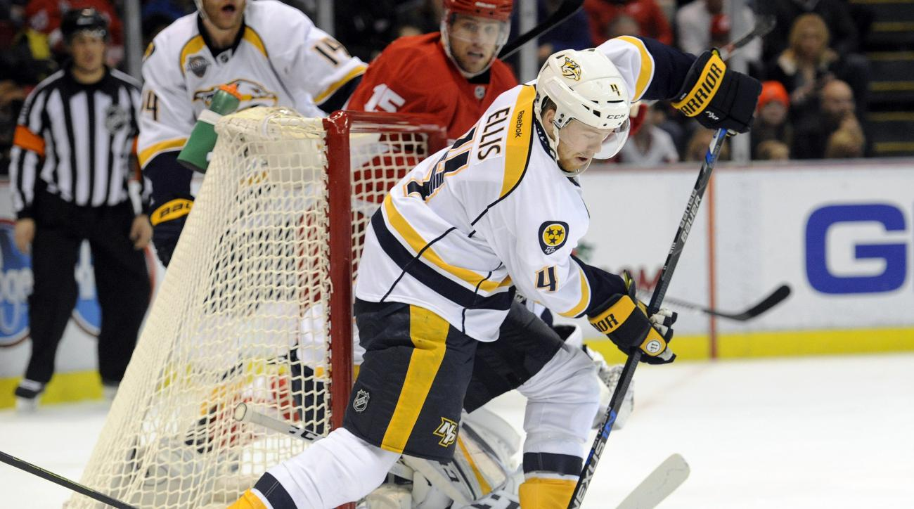Nashville Predators defenseman Ryan Ellis (4) skates with the puck against the Detroit Red Wings during the second period of an NHL hockey game in Detroit, Saturday, Dec. 5, 2015.  (AP Photo/Jose Juarez)
