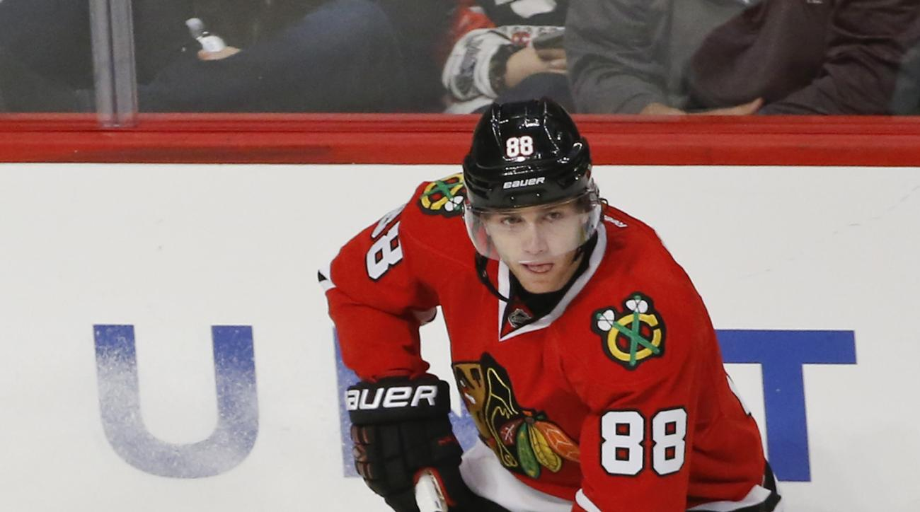 Chicago Blackhawks right wing Patrick Kane (88) looks to pass the puck against Winnipeg Jets during the third period of an NHL hockey game, Sunday, Dec. 6, 2015, in Chicago. The Blackhawks won 3-1. (AP Photo/Kamil Krzaczynski)
