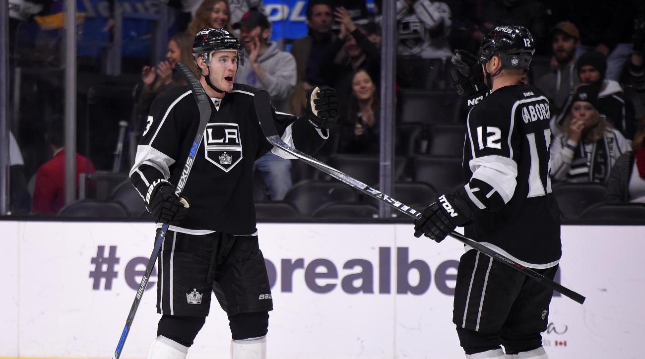 Los Angeles Kings defenseman Brayden McNabb, left, celebrates his goal with Los Angeles Kings right wing Marian Gaborik, of Slovakia, during the second period of an NHL hockey game against the Tampa Bay Lightning, Sunday, Dec. 6, 2015, in Los Angeles. (AP