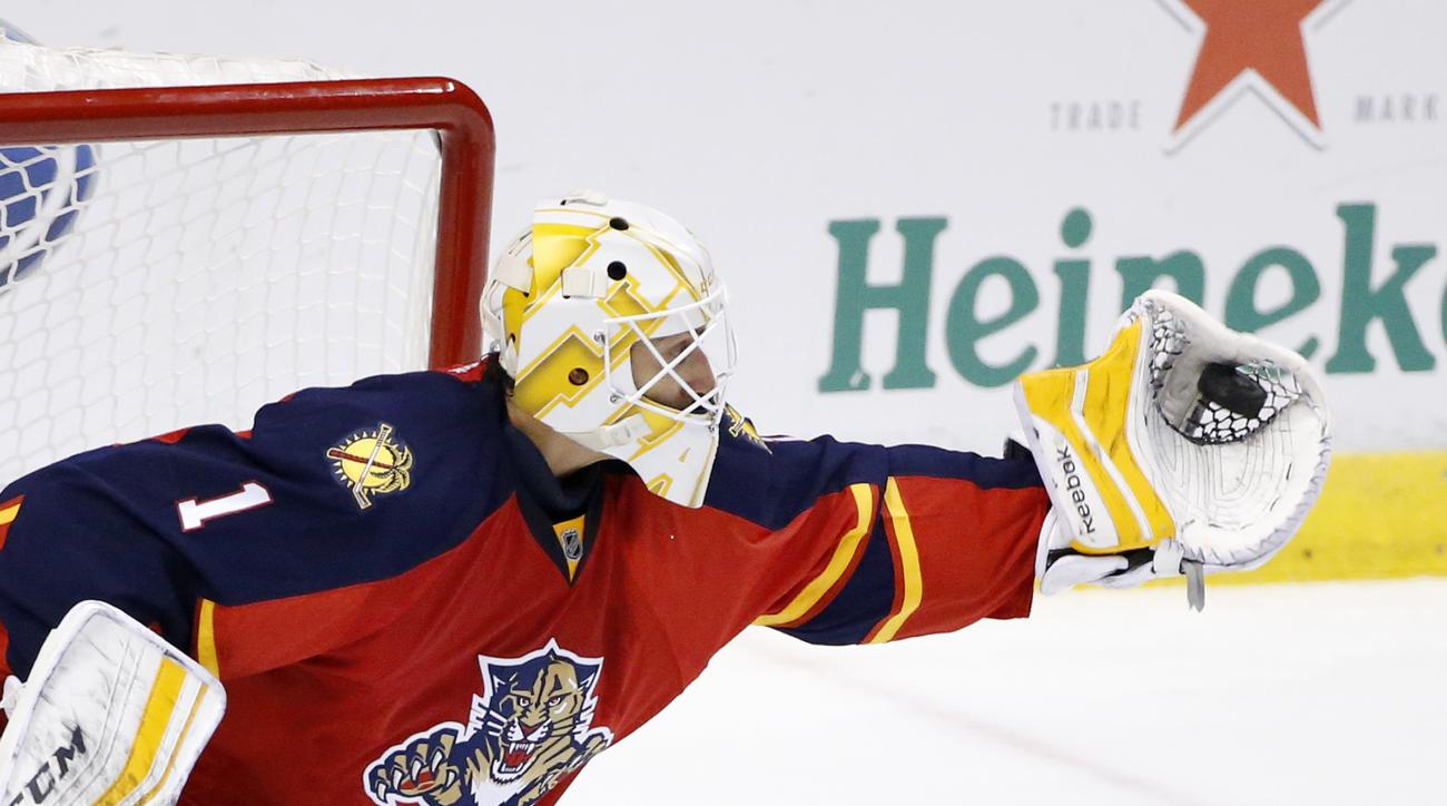 Florida Panthers goalie Roberto Luongo makes a save during the second period of an NHL hockey game against the Ottawa Senators, Tuesday, Dec. 8, 2015, in Sunrise, Fla. (AP Photo/Wilfredo Lee)