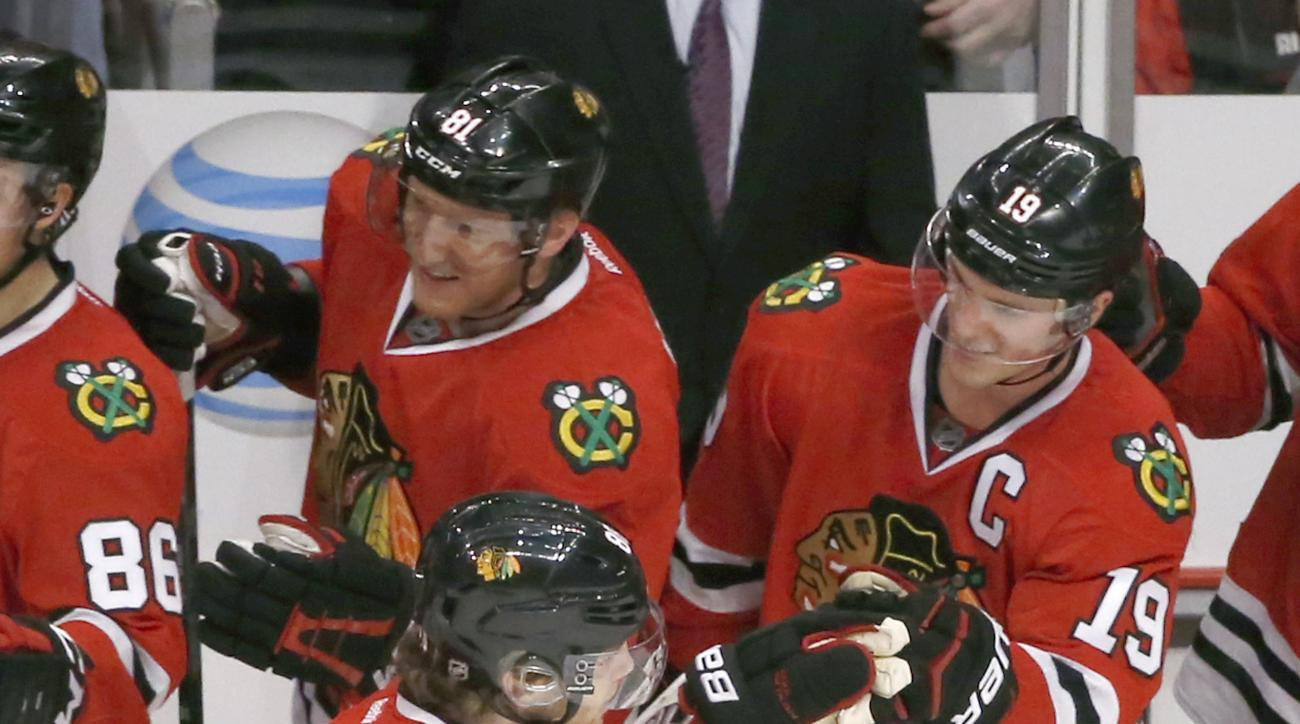 Chicago Blackhawks right wing Patrick Kane (88) celebrates his empty net goal with center Jonathan Toews (19) during the third period of an NHL hockey game against the Nashville Predators Tuesday, Dec. 8, 2015, in Chicago. Kane scored his 600th career poi