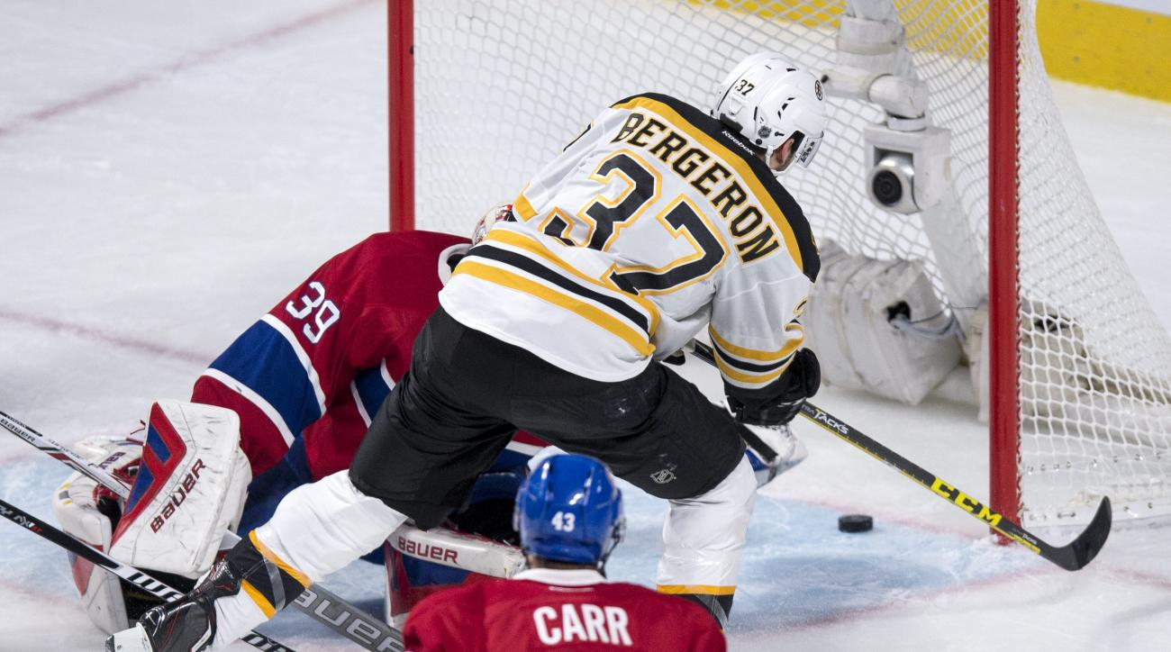 Boston Bruins' Patrice Bergeron (37) scores past Montreal Canadiens' goalie Mike Condon as Canadiens' Daniel Carr looks on during third period NHL hockey action, in Montreal, on Wednesday, Dec. 9, 2015. The Bruins defeated the Canadiens 3-1. (Paul Chiasso