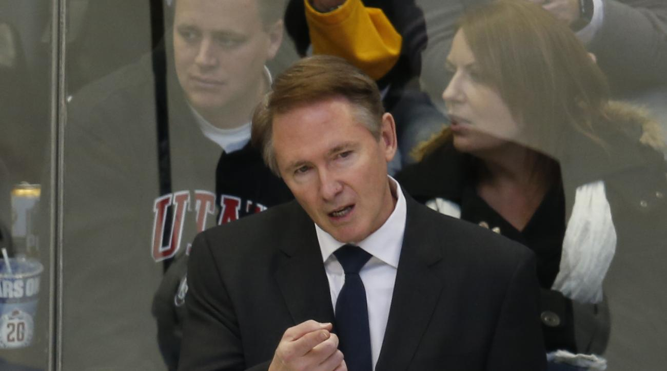 Pittsburgh Penguins head coach Mike Johnston directs his players against the Colorado Avalanche in the first period of an NHL hockey game, Wednesday, Dec. 9, 2015, in Denver. (AP Photo/David Zalubowski)