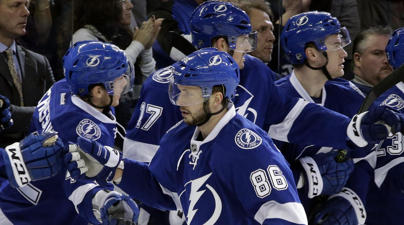 Tampa Bay Lightning right wing Nikita Kucherov (86), of Russia, celebrates with the bench after scoring against the Ottawa Senators during the first period of an NHL hockey game Thursday, Dec. 10, 2015, in Tampa, Fla. (AP Photo/Chris O'Meara)