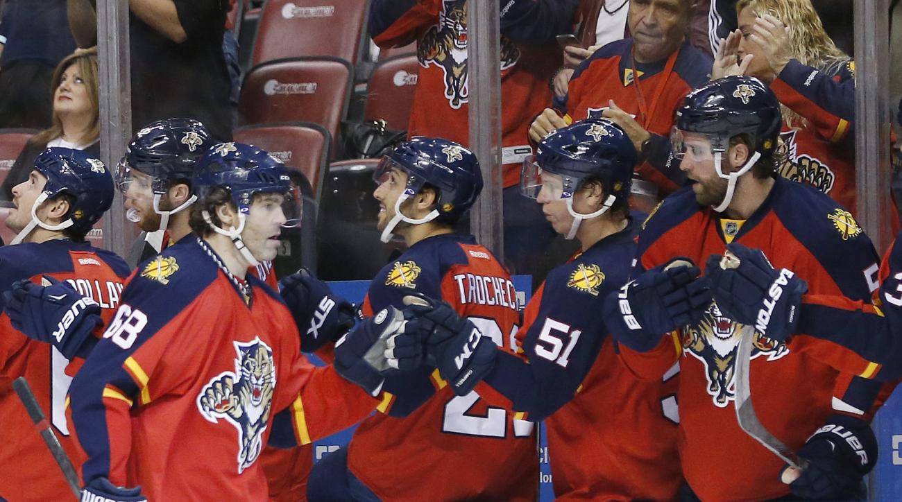Florida Panthers right wing Jaromir Jagr (68) is congratulated by teammates after scoring during the first period of an NHL hockey game against the Washington Capitals, Thursday, Dec. 10, 2015, in Sunrise, Fla. (AP Photo/Wilfredo Lee)