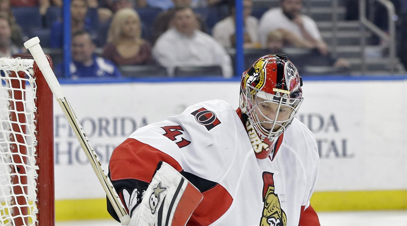 Ottawa Senators goalie Craig Anderson (41) makes a stick save on a shot by the Tampa Bay Lightning during the second period of an NHL hockey game Thursday, Dec. 10, 2015, in Tampa, Fla. (AP Photo/Chris O'Meara)
