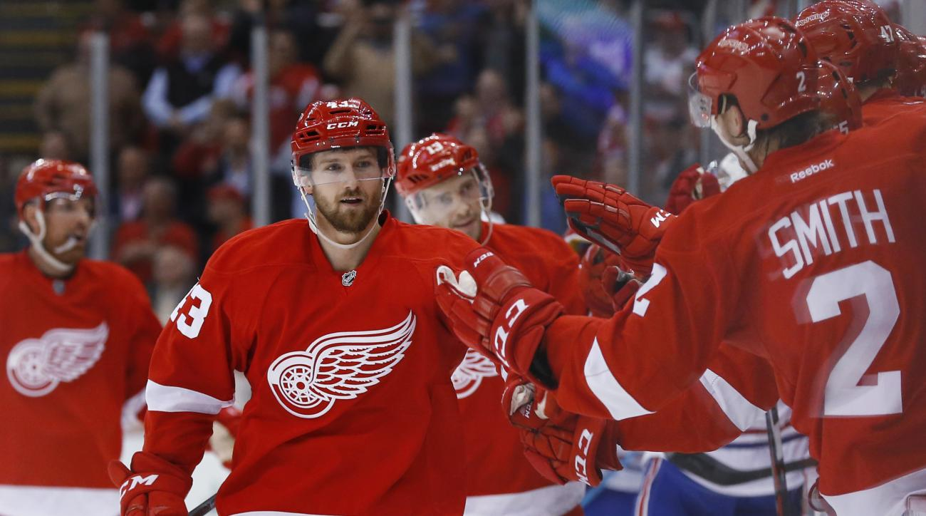 Detroit Red Wings center Darren Helm (43) celebrates his goal against the Montreal Canadiens in the third period of an NHL hockey game Thursday, Dec. 10, 2015 in Detroit. (AP Photo/Paul Sancya)
