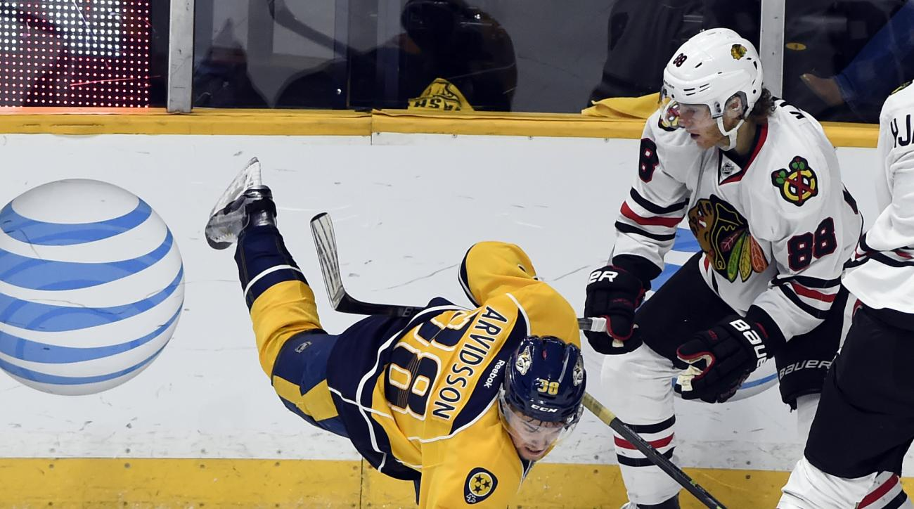 Chicago Blackhawks right wing Patrick Kane (88) checks Nashville Predators left wing Viktor Arvidsson (38), of Sweden, to the ice in the third period of an NHL hockey game Thursday, Dec. 10, 2015, in Nashville, Tenn. The Predators won 5-1. (AP Photo/Mark