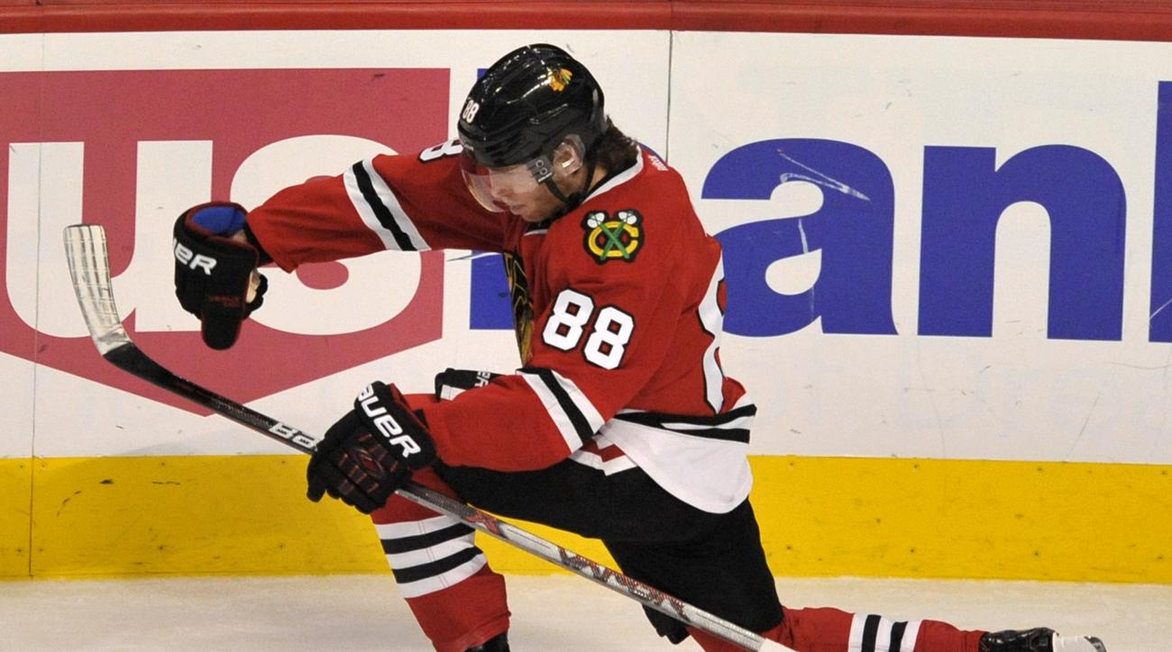 Chicago Blackhawks' Patrick Kane (88), celebrates after scoring a goal during the second period of a hockey game against the Winnipeg Jets Friday, Dec. 11, 2015, in Chicago. (AP Photo/Paul Beaty)