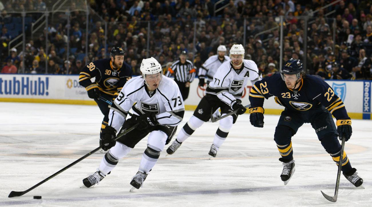Los Angeles Kings center Tyler Toffoli (73) skates past Buffalo Sabres center Sam Reinhart (23) during the second period of an NHL hockey game, Saturday Dec. 12, 2015, in Buffalo, N.Y. (AP Photo/Gary Wiepert)