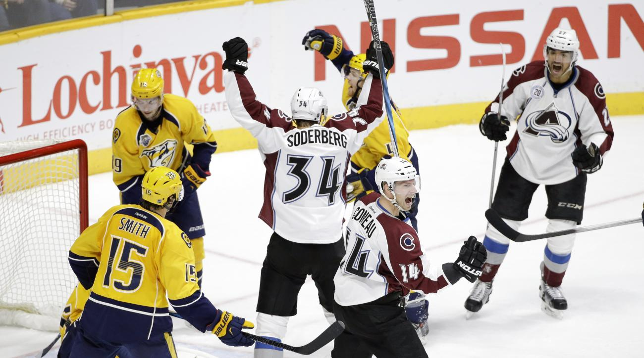 Colorado Avalanche left wing Andreas Martinsen, of Norway, upper right, celebrates with Carl Soderberg (34), of Sweden, and Blake Comeau (14) after Martinsen scored a goal against the Nashville Predators in the third period of an NHL hockey game Saturday,