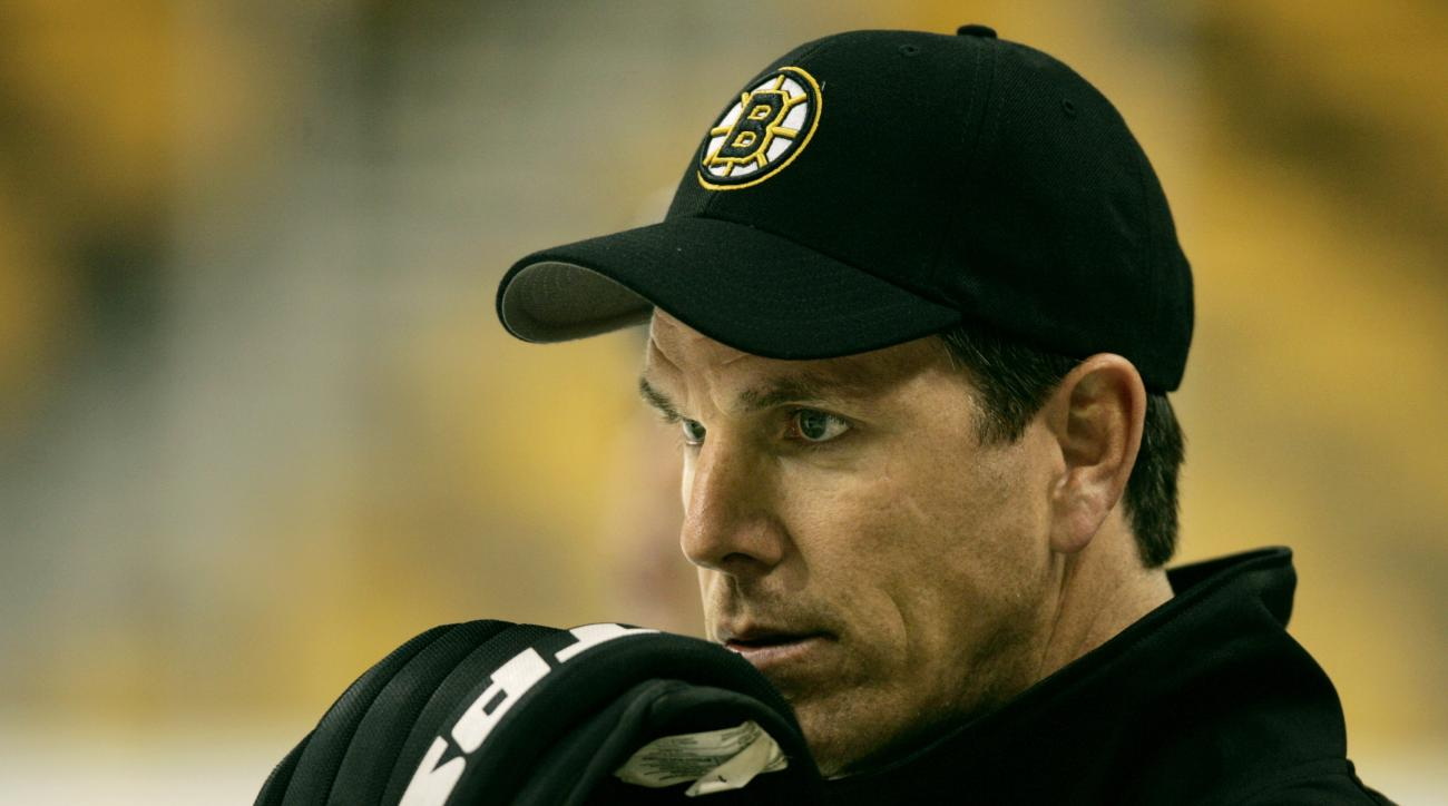 Boston Bruins head coach Mike Sullivan watches his team skate during practice in Boston, Monday, Sept. 12, 2005.  With the season-long NHL lockout over, the Bruins return to the ice for their first regular season game against the Montreal Canadiens Oct. 5